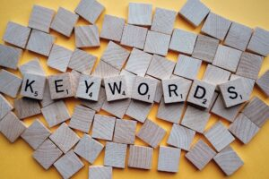 """scrabble letters spelling out """"keywords"""" for keyword use from your digital marketing agency"""